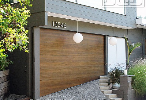 Mid Century Style Garage Door With Uneven Bottom For Sloping Grounds