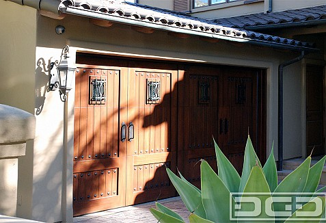 Faux stained composite garage doors and out swing carriage for Composite wood garage doors