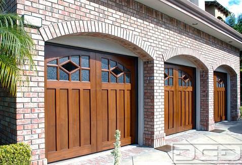 Custom Crafted Garage Doors With Designer Windows In Solid Mahogany Dynamic Garage Door Projects