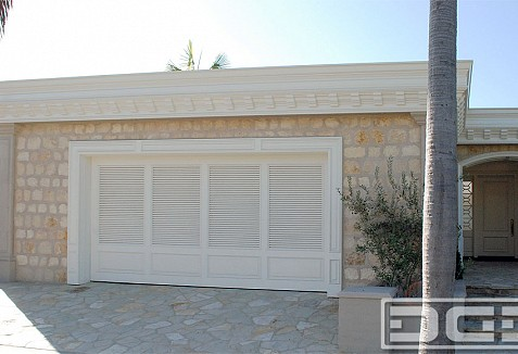 Coastal Custom Garage Doors Designed In A Louvered Shutter Style