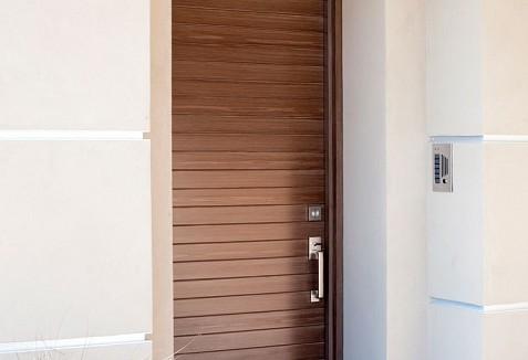 Modern style garage doors matching entry doors in for Wood composite garage doors
