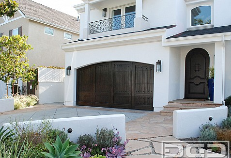 Custom spanish mediterranean garage doors matching entry for Mediterranean style entry doors