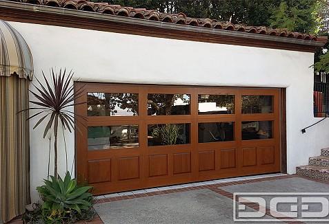 Custom Designed Spanish Garage Door Matching Automatic Driveway