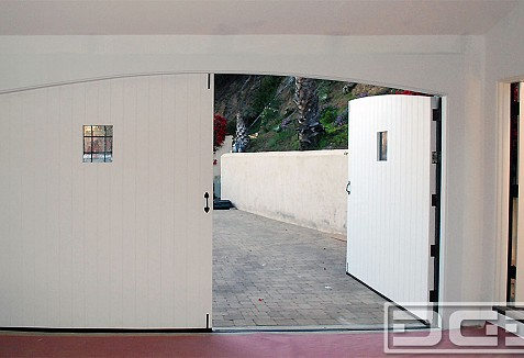 Custom Carriage Doors Made In A Spanish Colonial Architectural Style Dynamic Garage