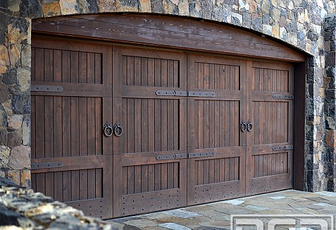Tuscan garage doors carriage doors in a rustic wood Italian garage doors