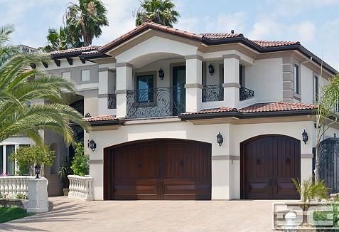 Mediterranean style garage doors custom made in southern for Mediterranean garage doors