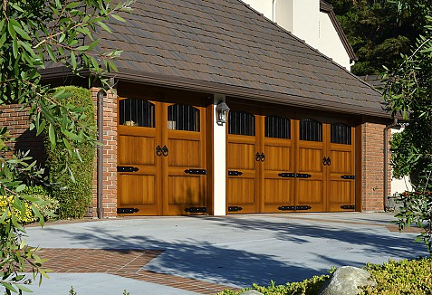 Composite carriage style garage doors with decorative iron for Composite wood garage doors