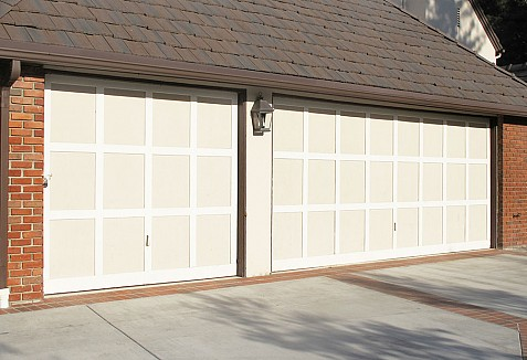 Composite carriage style garage doors with decorative iron for European garage doors
