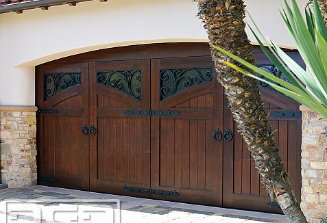 Custom made french mediterranean style garage doors for for Mediterranean style entry doors