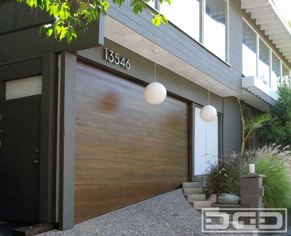 Asymmetrical Garage Door for a Carport