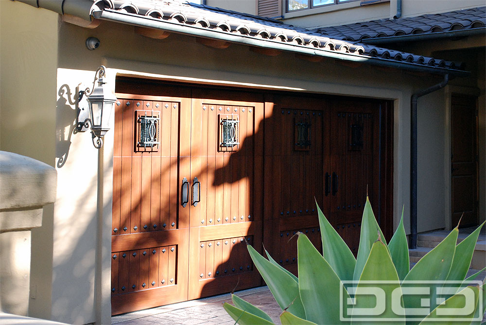 Composite garage doors custom designed handcrafted in for Eco friendly doors